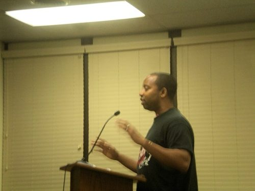 Troy Bynum, whose late brother Terry Bynum-Copeland co-founded Terry's Serendipity Café, speaks on behalf of the café at the Montclair Township Council's September 20 meeting.