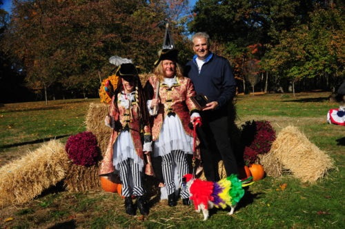 Essex County Executive Joseph N. DiVincenzo, Jr. (right) congratulates Jean Dabrowski from Montclair and their dog Jimmy, who were dressed as pirates and parrot, for winning Third Place in the Group Costume Category. (Photo by Glen Frieson)