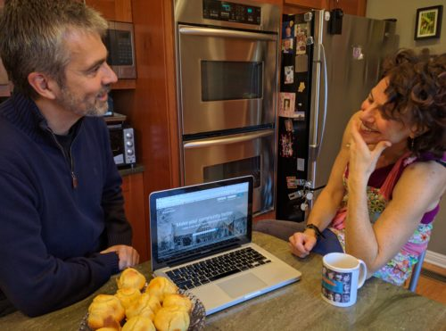 """PLANETCIVIC founder and Montclair resident Javier Guardo showing Alma Schneider how to create her """"bus buddies"""" proposal."""