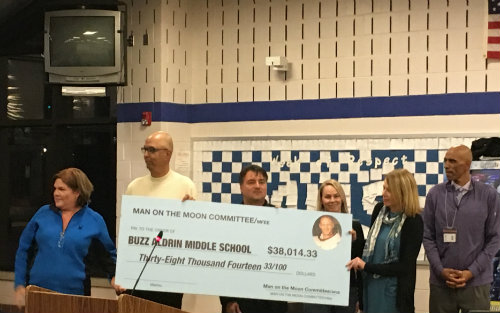 Montclair BOE accepted a $38,041.33 check from the Man on the Moon Committee on behalf of  the Buzz Aldrin Middle School.