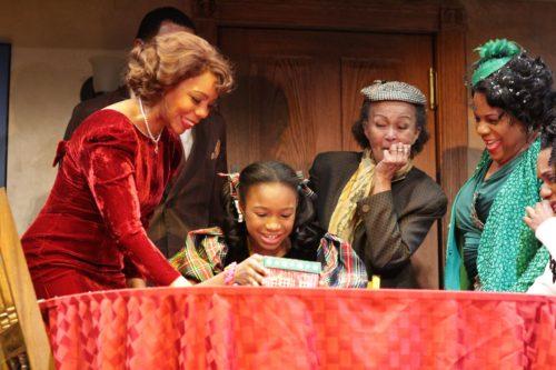 Soara Joye Ross as Deloris and Nia Bonita Caesar as Young Noel.