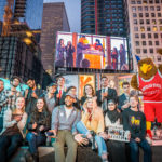Montclair State University Mascot Rocky the Red Hawk and Pres. Susan Cole on Times Square Billboard