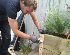 Harrison Gardens installing a raised bed