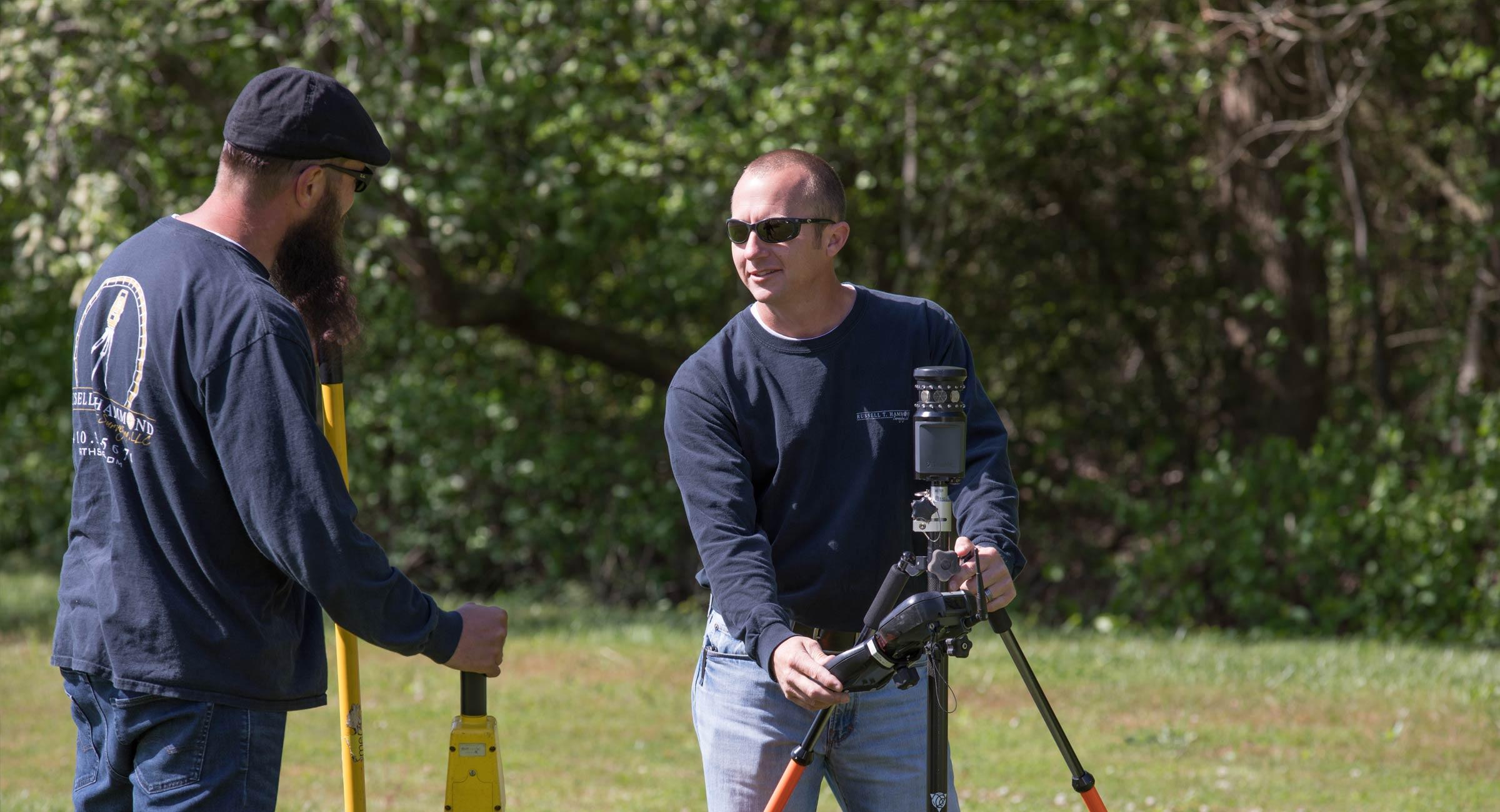 Surveyor at work on land plot