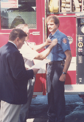 Randy Groves, promotion to Captain by Fire Chief Bill Bass, badge pinned by Deputy Chief Buzz Buzalsky, June 1, 1991
