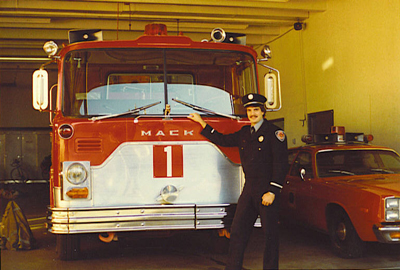 Firefighter Randy Groves in front of Eugene Fire Department Engine 1