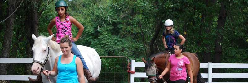 Kids horseback riding at summer camp