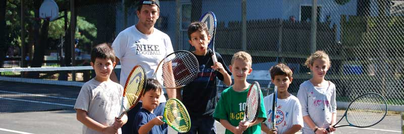 Group of young tennis players at summer camp