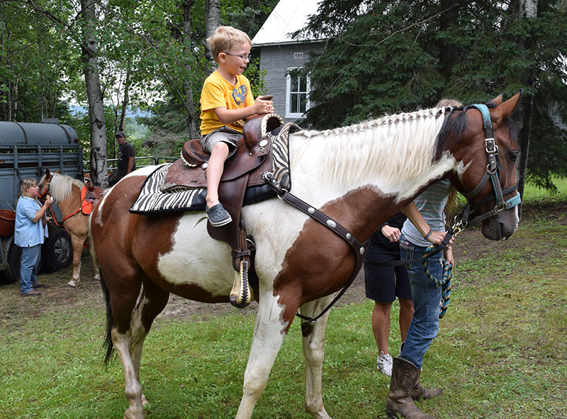 Boy Participating in Activities - Riding Horse