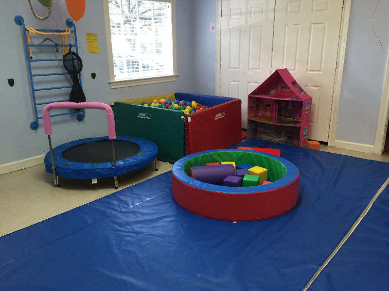 sensory integration gym for occupational therapy with ball pit and trampoline