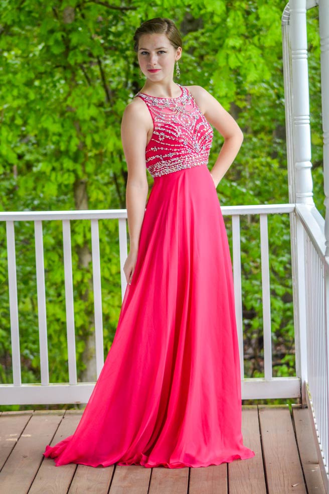 young girl in red prom dress from front