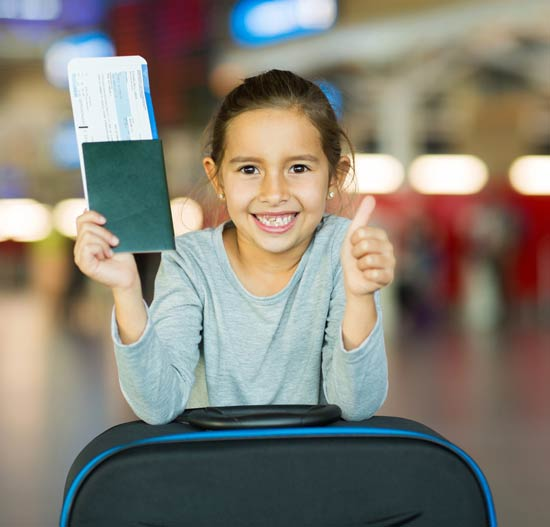 Smiling girl in airport with her ticket