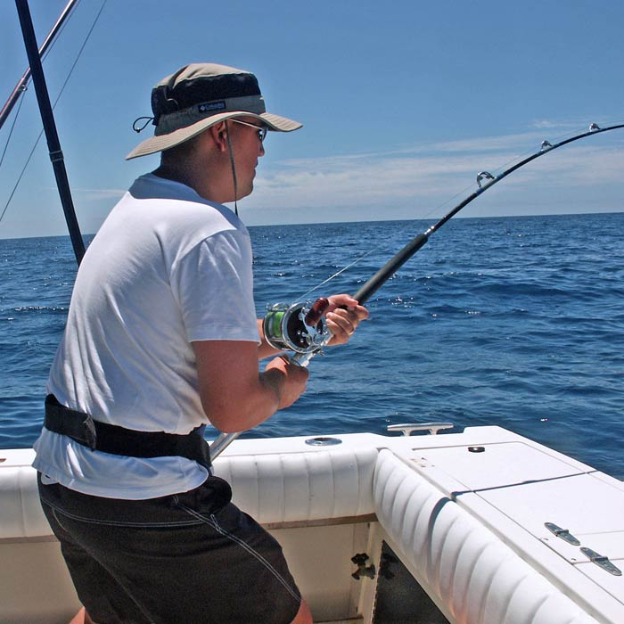 Man reeling in a fish offshore of Ocean City MD