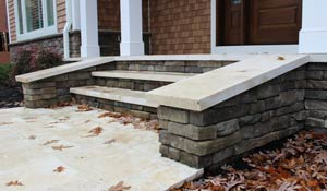 Custom stonework front step to house