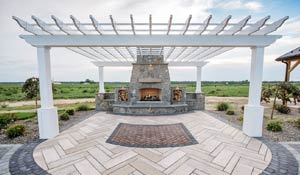 Outdoor living space with fireplace and trellis