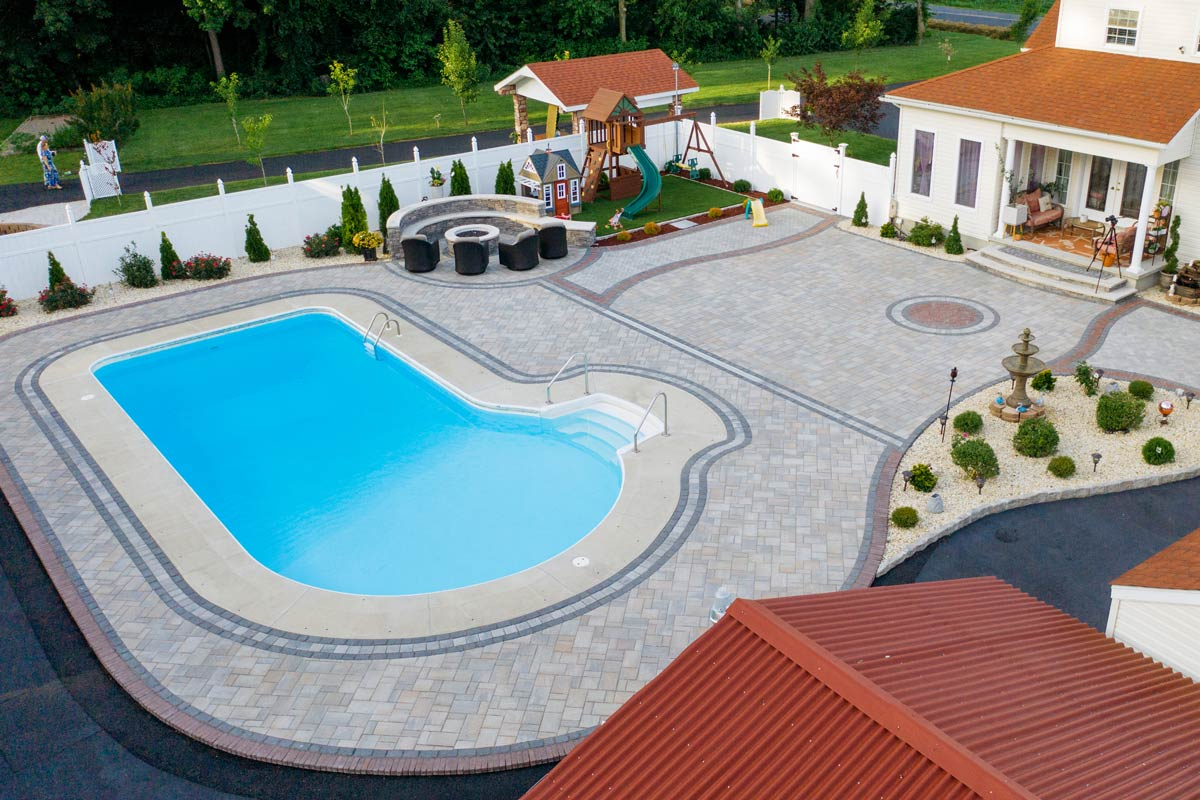 Hardscaped backyard with a swimming pool