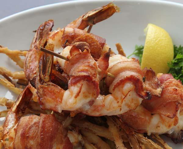 Closeup photo of bacon wrapper shrimp dish