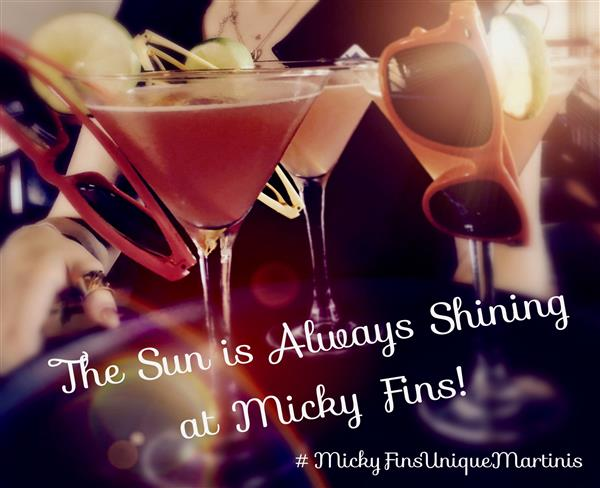 The sun is always shining at Micky Fins text over photo of cocktails