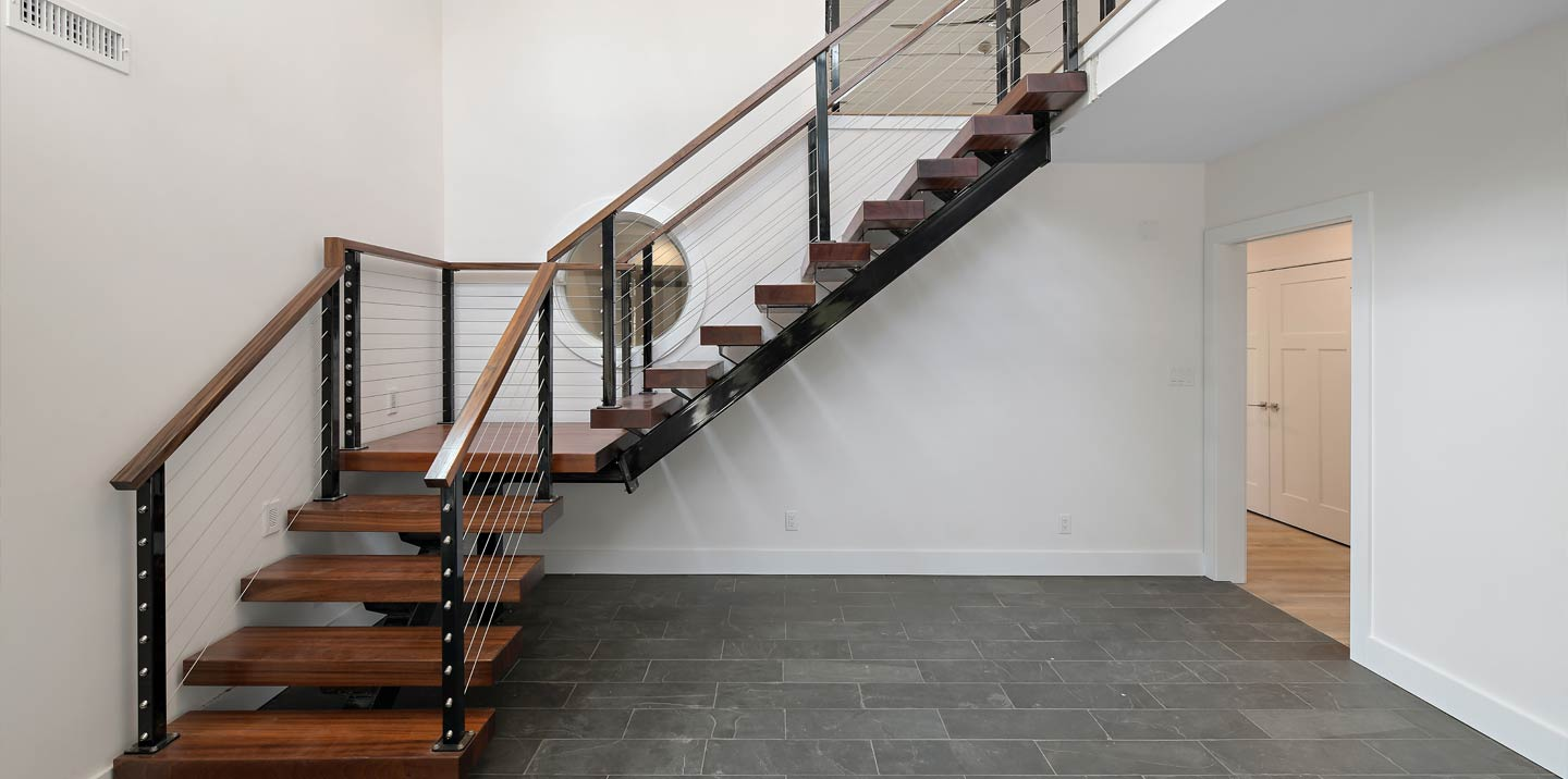 Custom designed and built stairway in new home