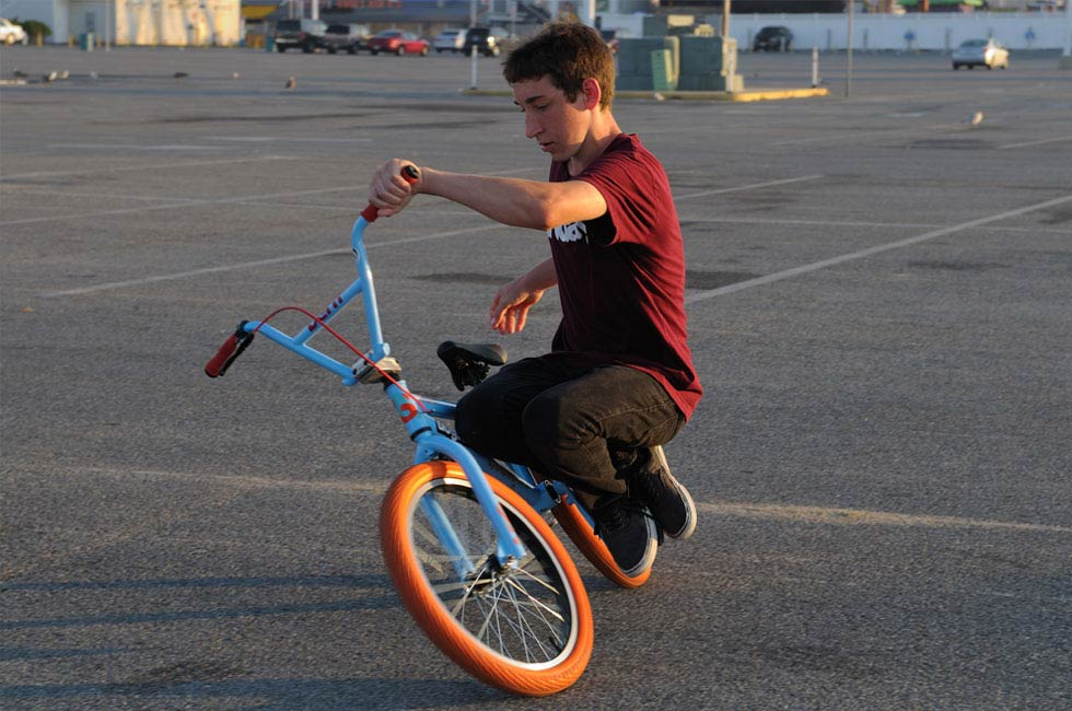 BMX riders doing a trick