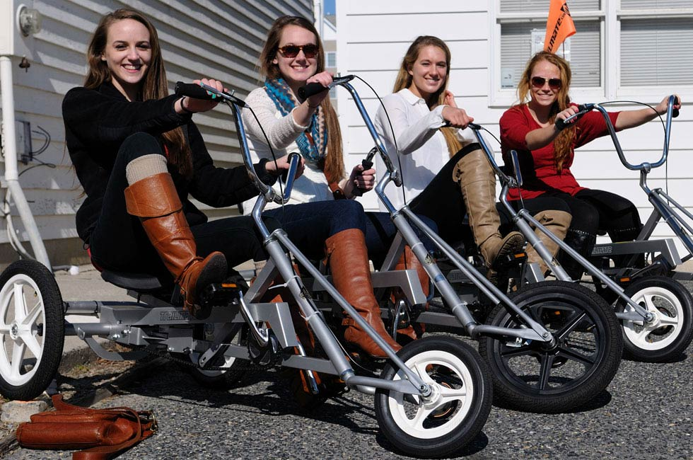 Girls smiling on low-rider Chopper bikes