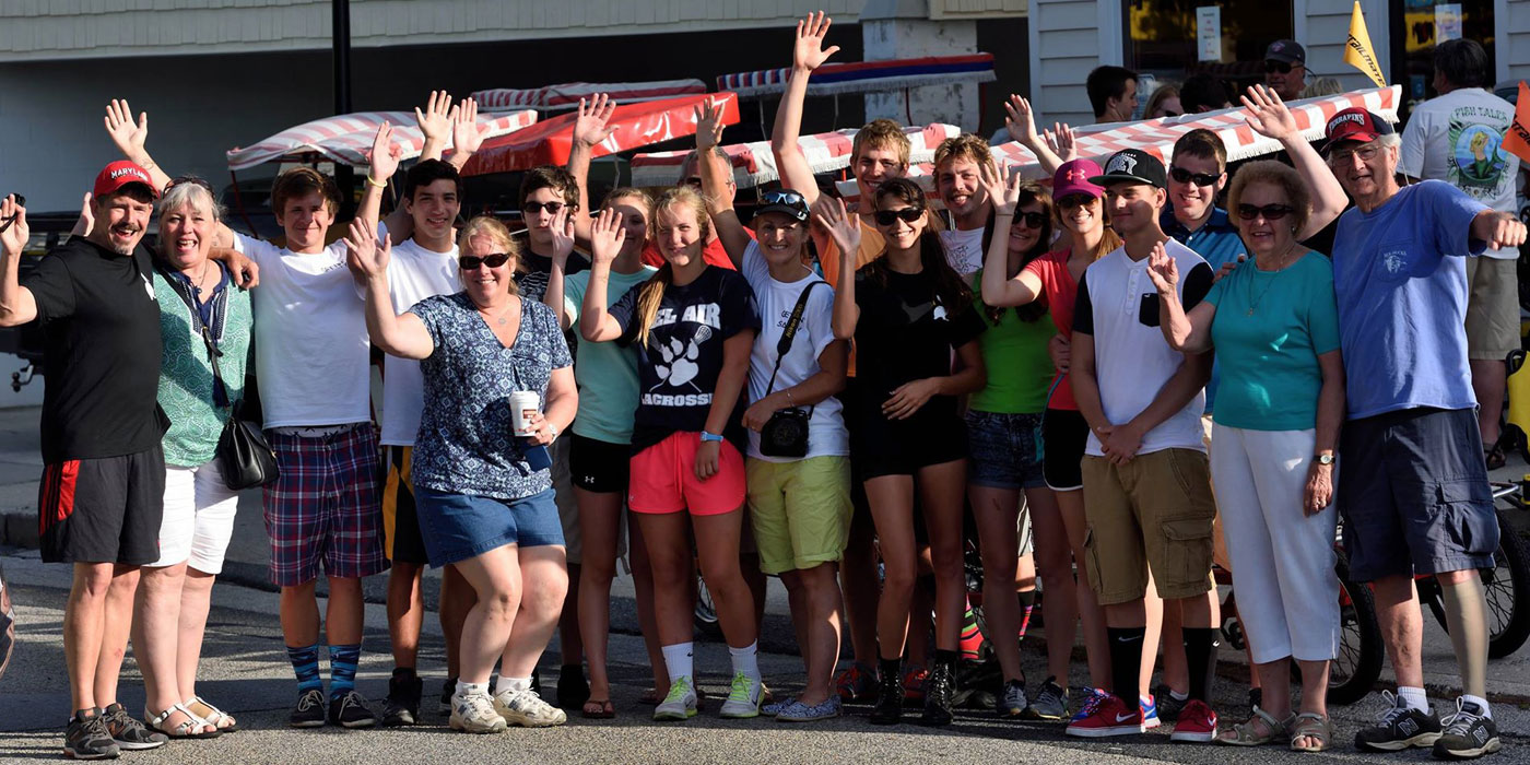Group of people outside of Bike World posing for the camera