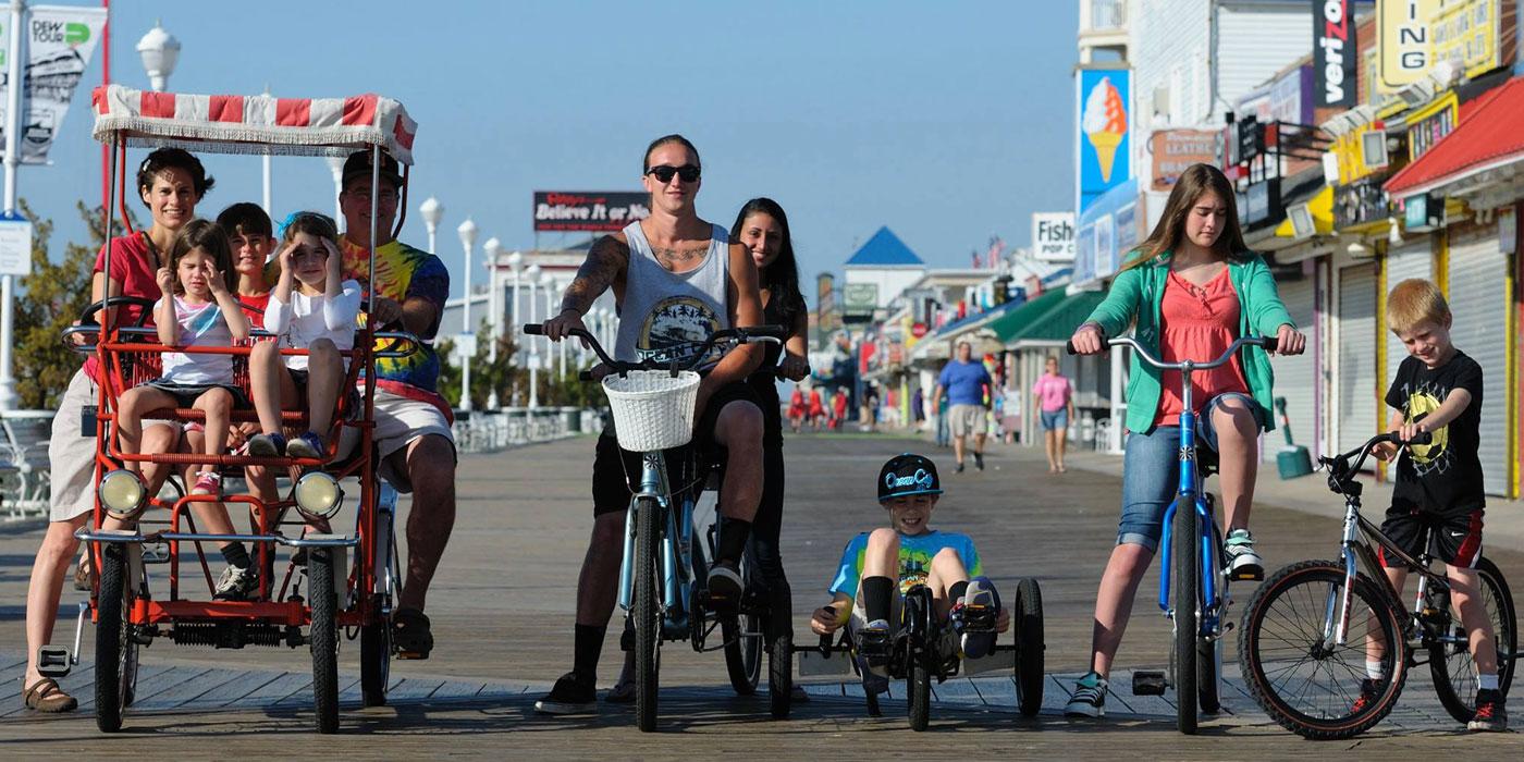 Ocean City Maryland tourist sitting on bikes on the Boardwalk