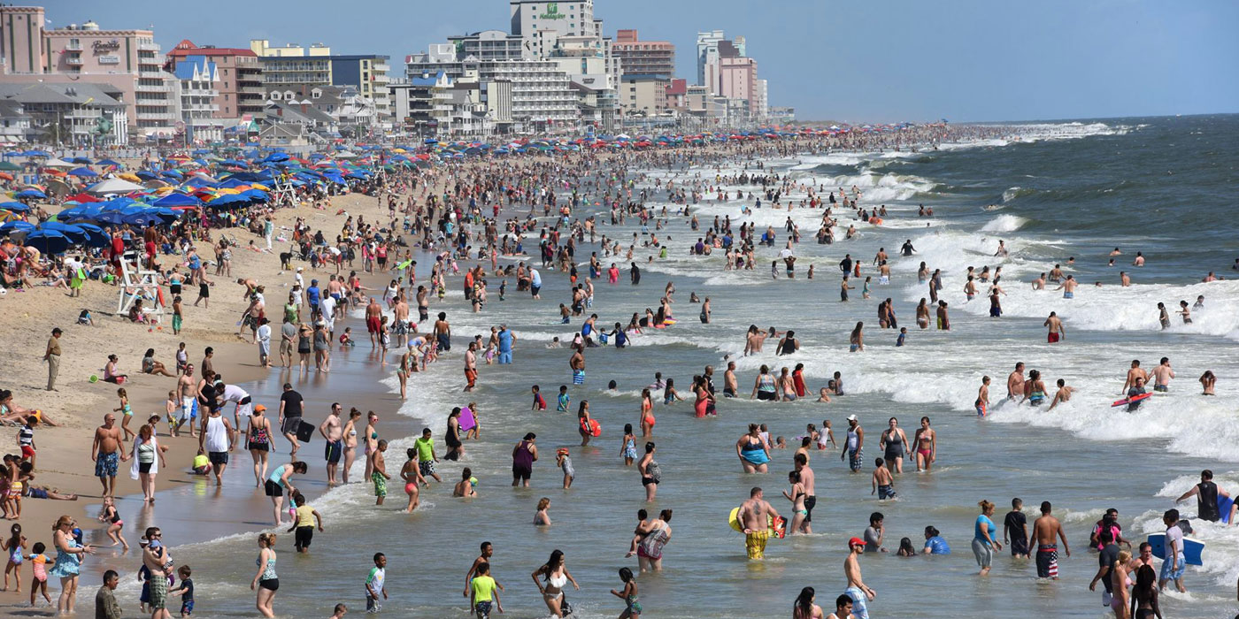 thousands of vacationers on the beach in Ocean City Maryland
