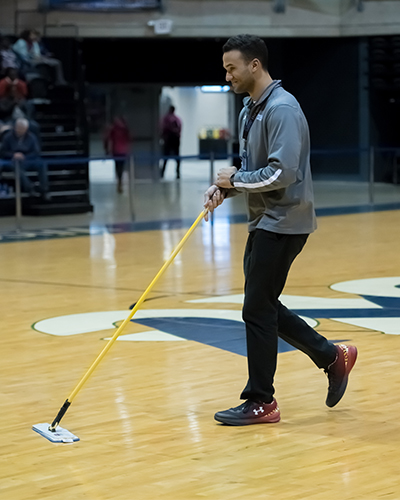 Volunteer cleaning basketball court