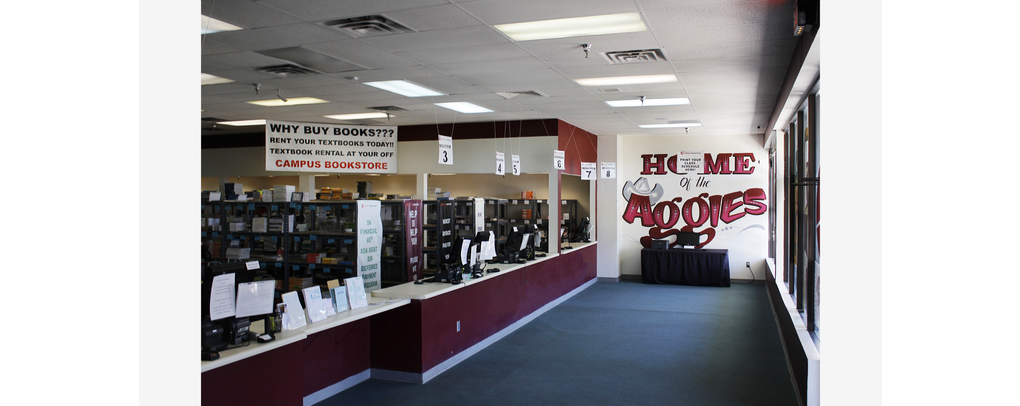 PICTURE OF BANNER ON WALL INSIDE CAMPUS BOOKSTORE