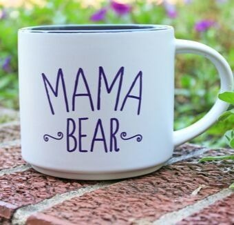A white mug that says Mama Bear