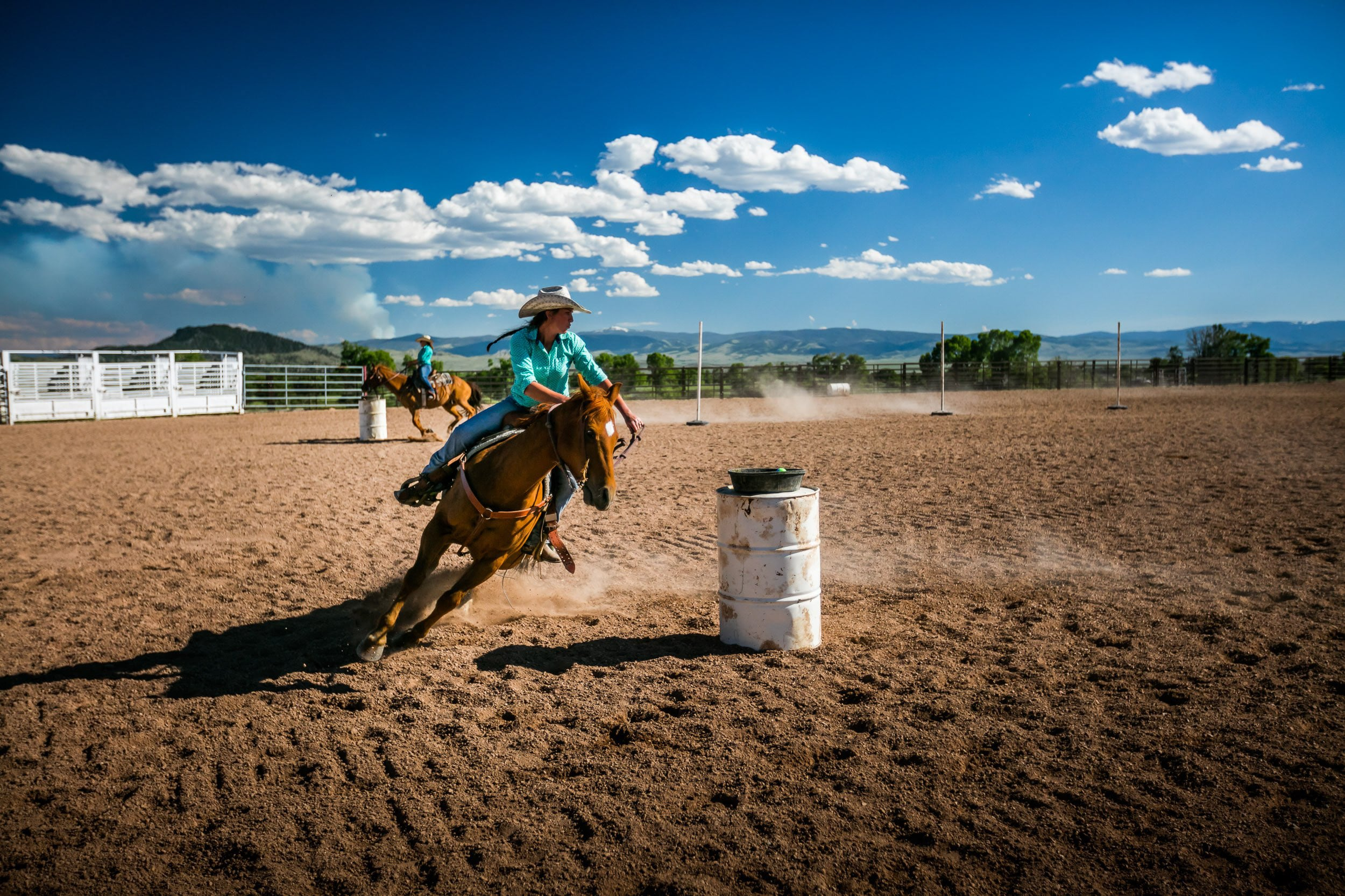 A person testing his skills in a barrel racing at Brush Creek Luxury Ranch