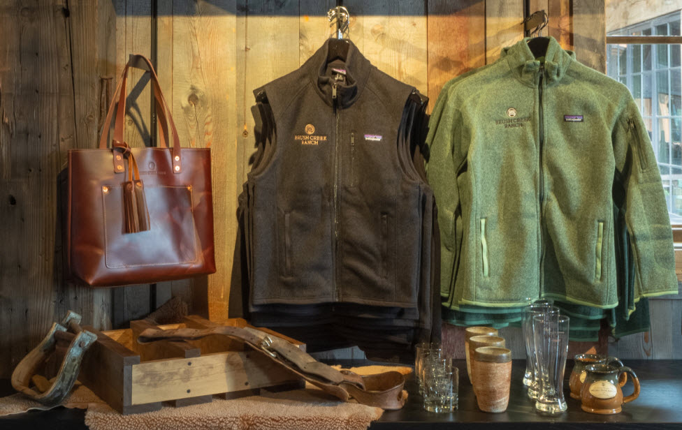 Hand-picked clothing, accessories, and housewares displayed inside the Brush Creek Luxury Mercantile at The Farm