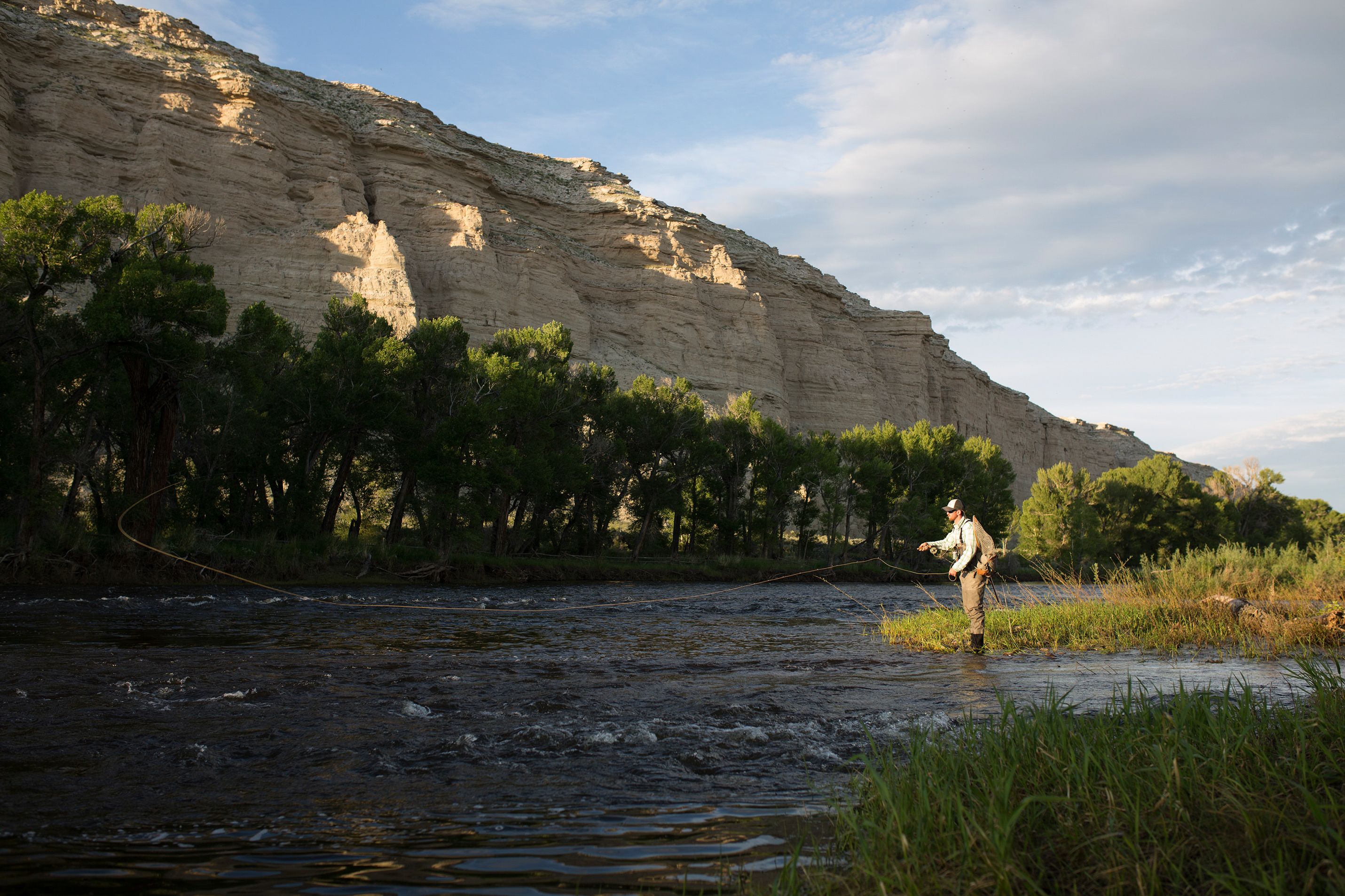 A fisherman using the premium Orvis and Beretta gear to perform the best catch at French Creek Sportsmen's Club
