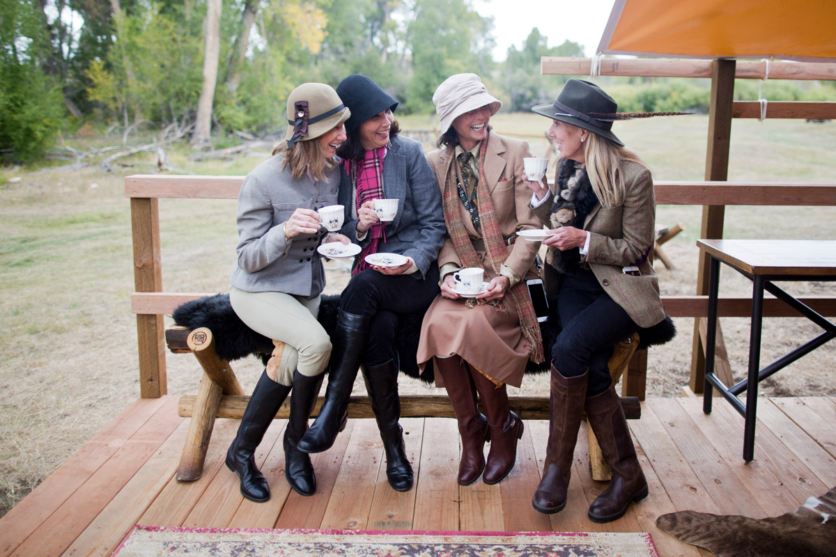 Women enjoying tea time in their traditional elevens