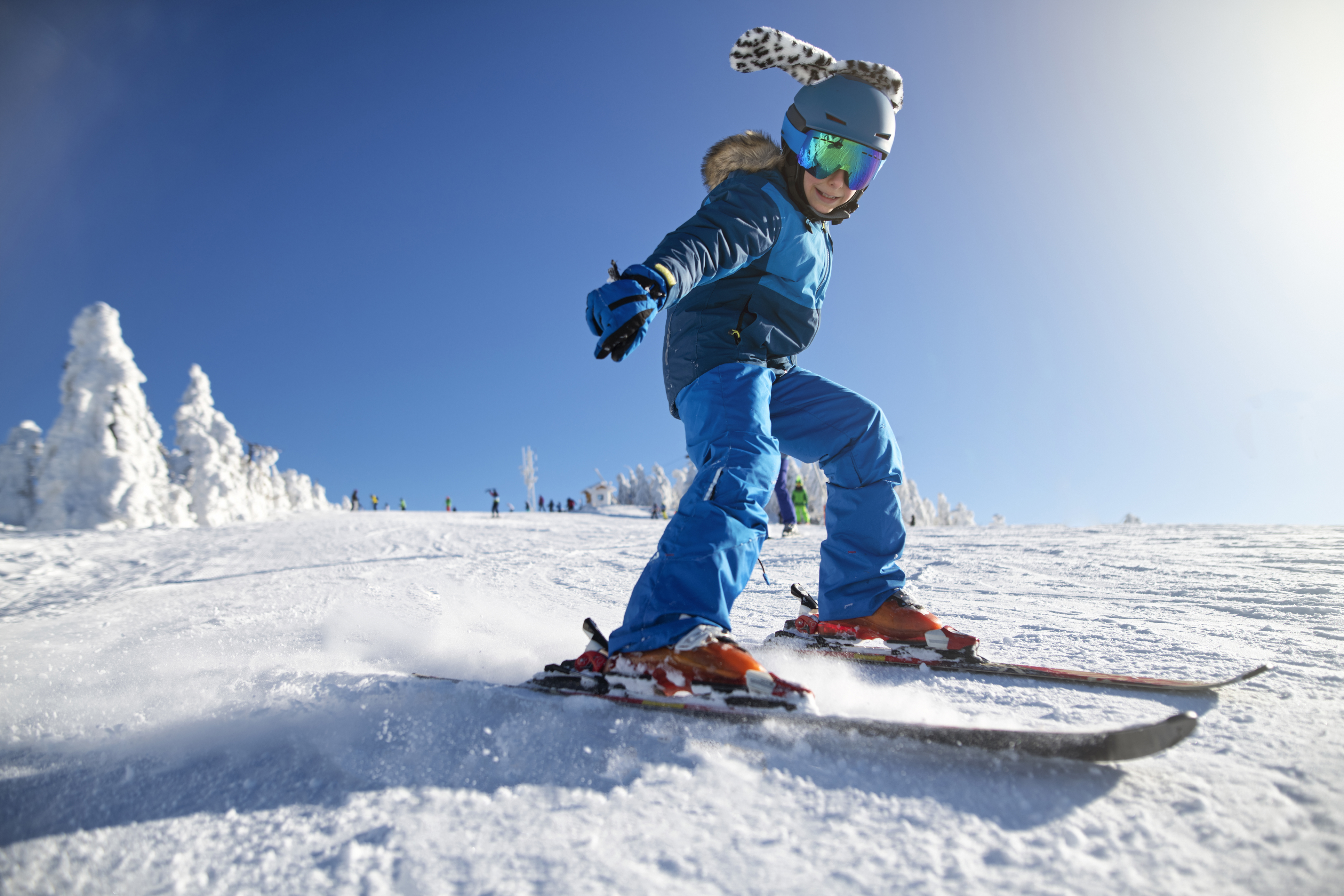 A young kid skiing down the hills of Green Mountain at Brush Creek Luxury Ranch Collection