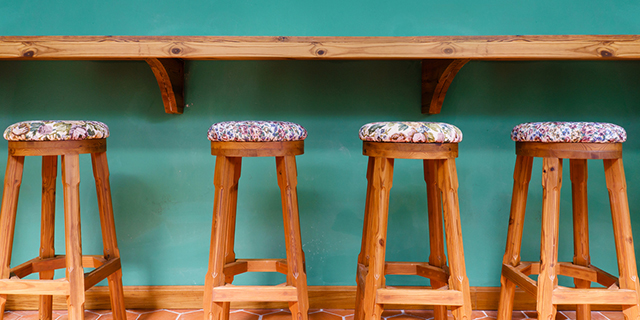 Vintage wooden stool chairs will help add an edge to your interiors.