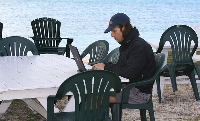 Online business gives you flexible times to work and you can travel anywhere you have an internet connection. Brandon working after a day of fishing in the Bahamas.