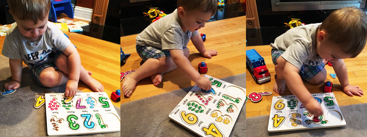 Top banner - toddler playing with numbers