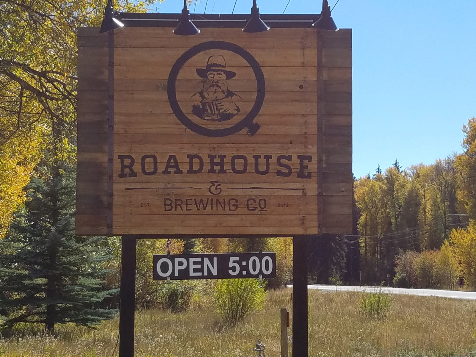 Q Roadhouse sign on highway
