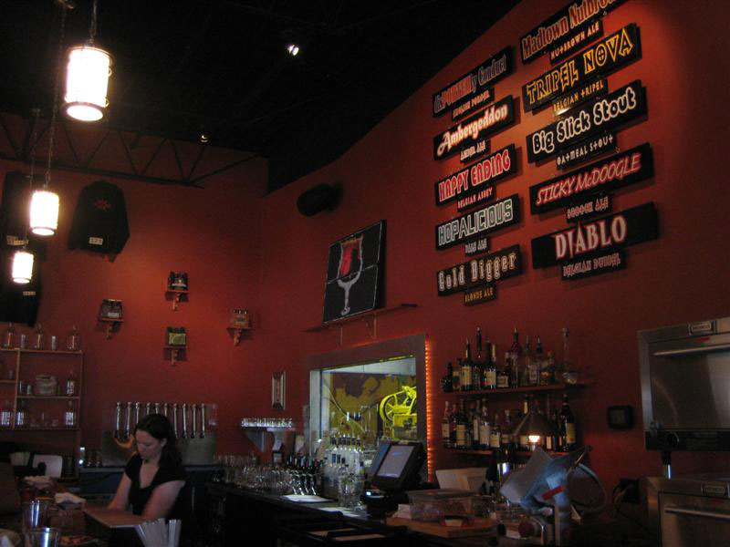 The wall of beer selections at Ale Asylum