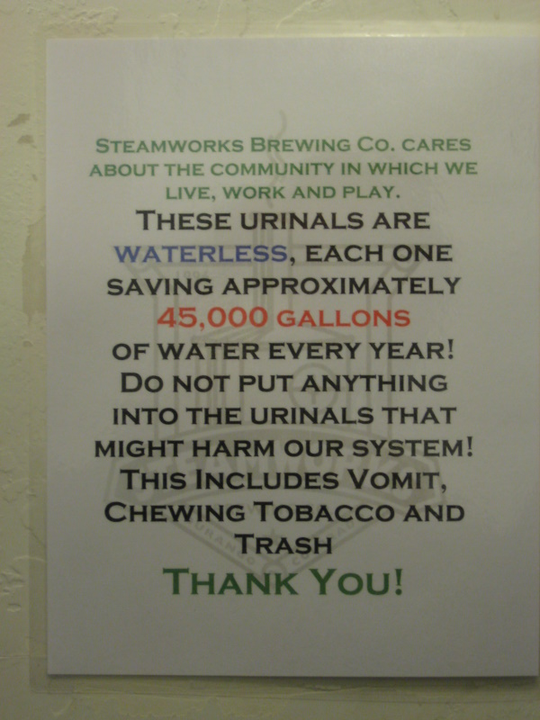 sign above beer recycle station