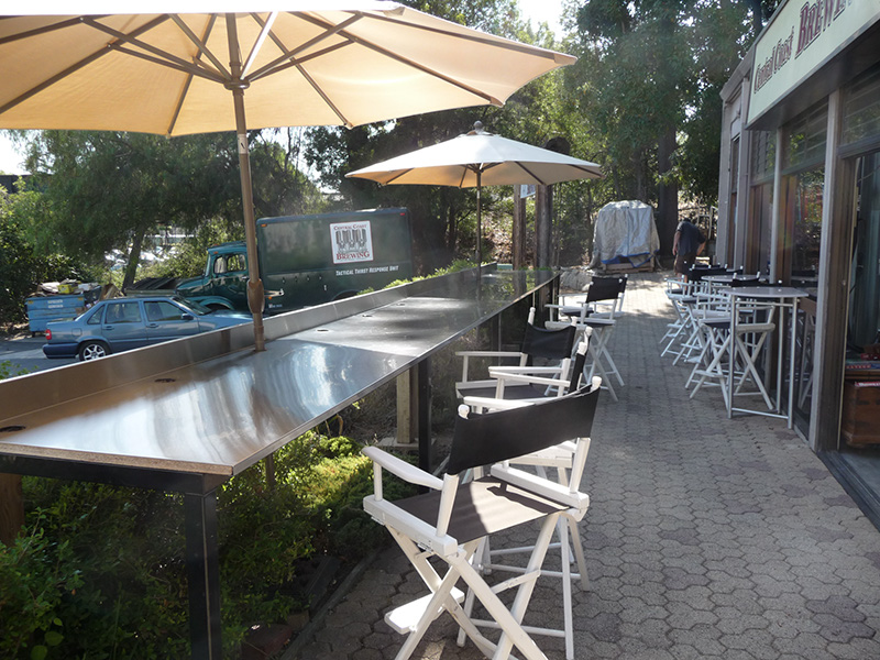 Outdoor seating overlooking the street and parking lot