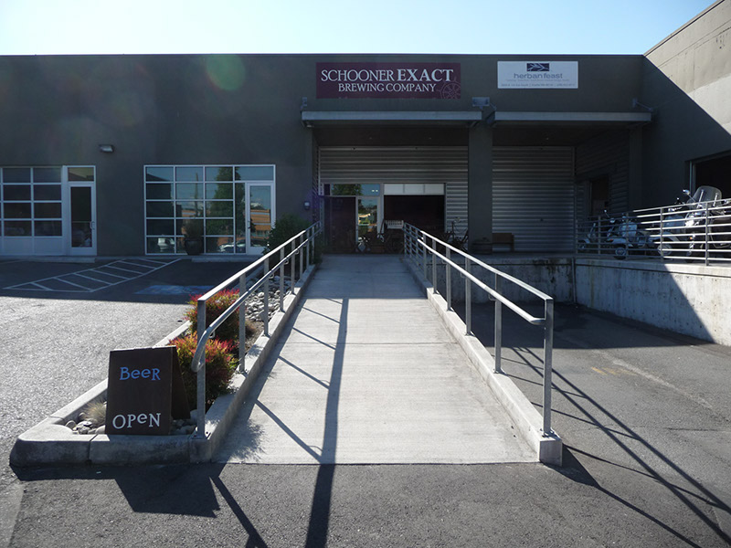 The entrance and outdoor seating seen from the parking lot