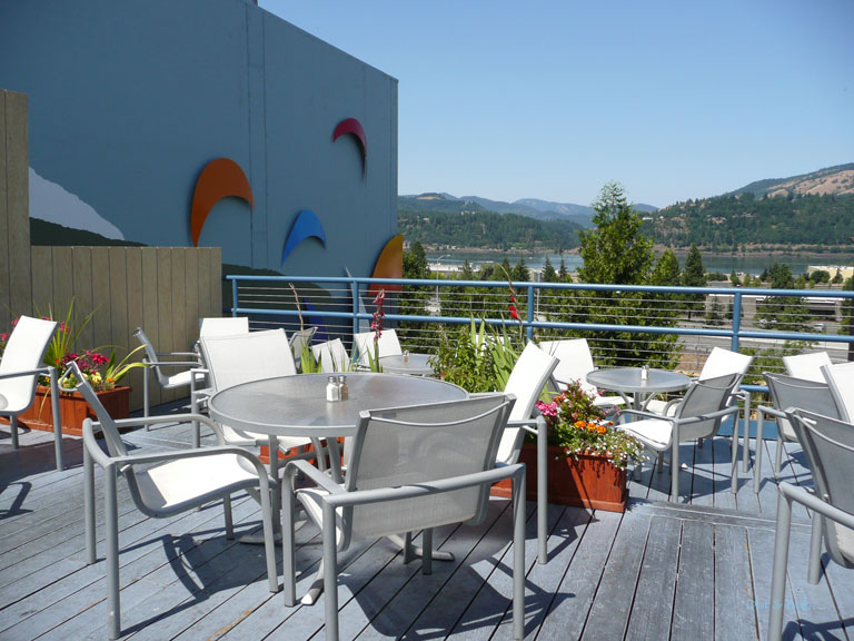 The outdoor tables on the deck overlooking the Columbia River
