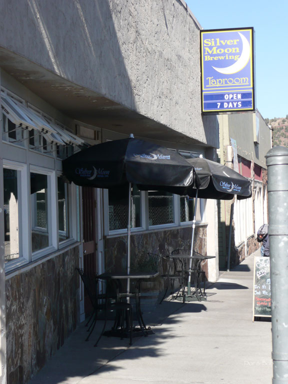 The front entrance and outdoor tables from the sidewalk