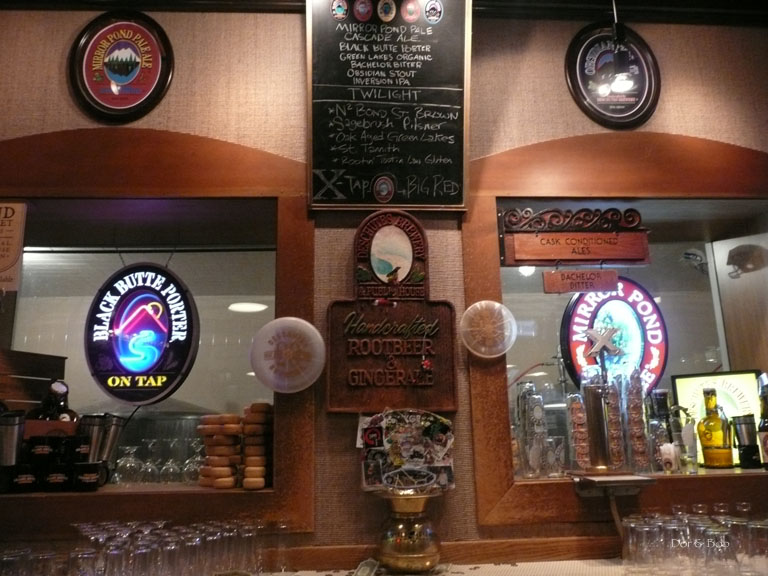 Behind the bar with a glimpse of the brewery