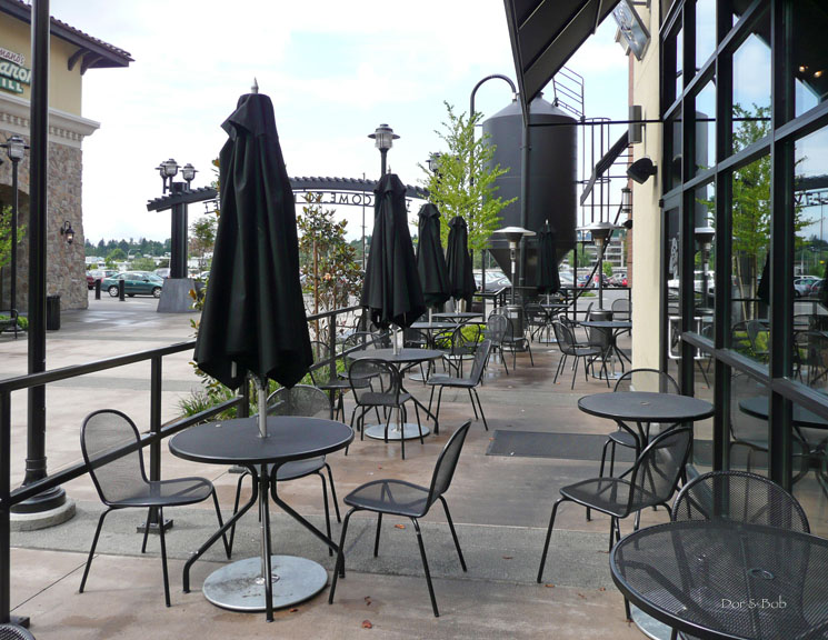 Outdoor seating on the patio alongside the walkway to the mall entrance