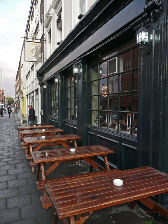 The front entrance with outdoor tables from the sidewalk