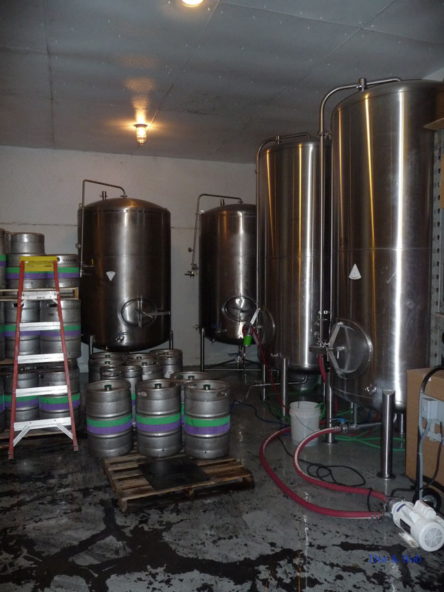 The storage tanks and kegs in the tasting / cold storage room